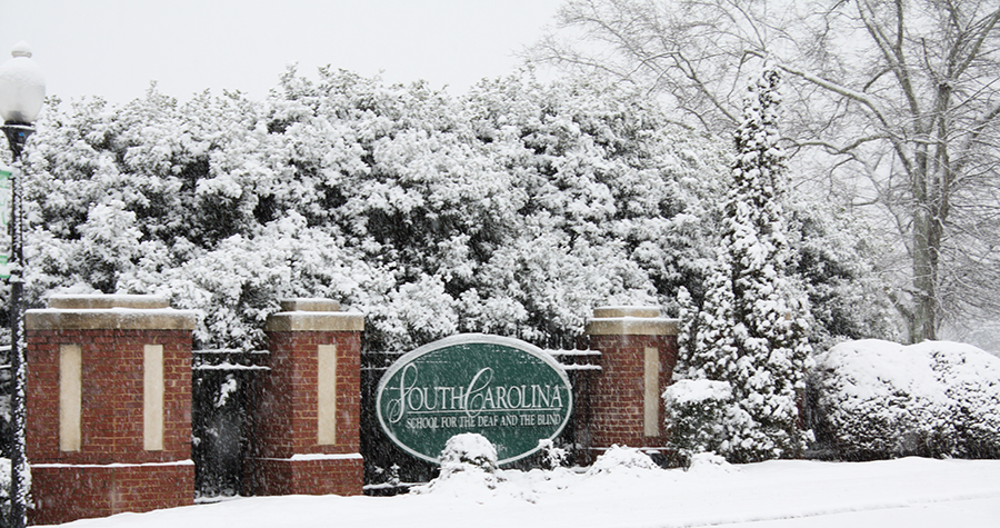 Snow scene of front entrance sign at the South Carolina School for the Deaf and the Blind