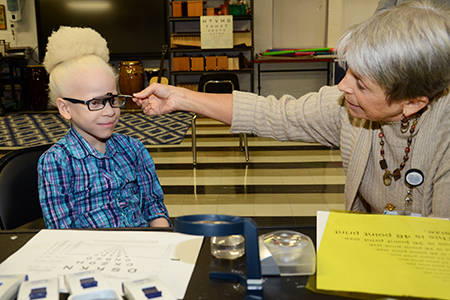 Shirley Anderson works with Chasity Turner to determine which magnifier is best. Ms. Anderson is with the Storm Eye Institute and Low Vision Rehabilitation Services of the Medical University of South Carolina.