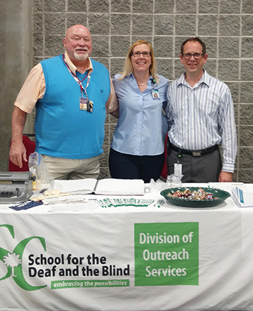 Outreach team members Tim Johnson, Kelly Birmingham, and Eric Weber shared information at a recent career fair.