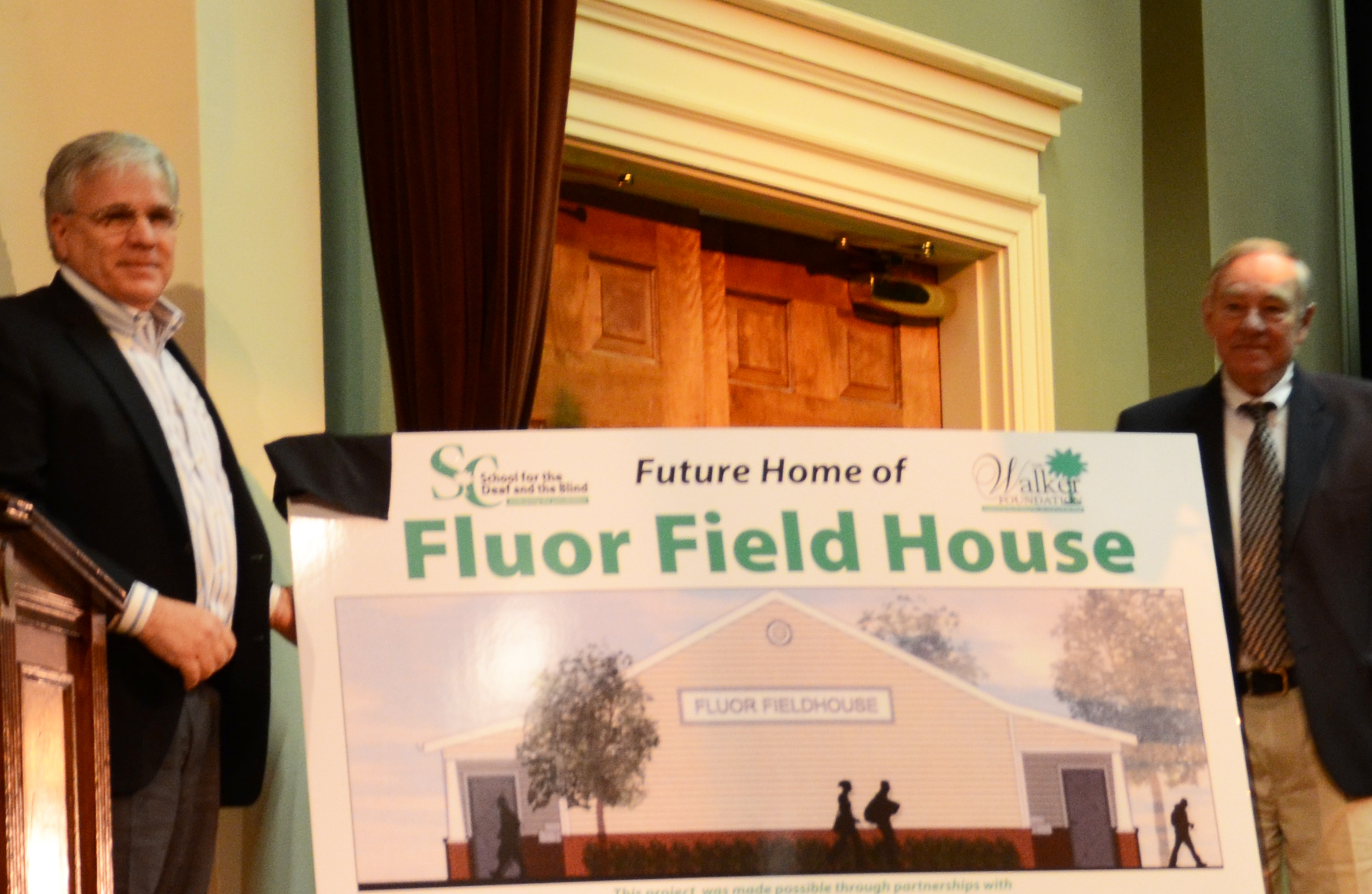 Don Finkell and Bobby Dobson unveiled the sign announcing the Fluor Field House.