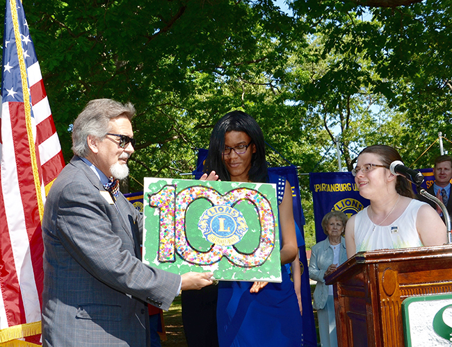 The Leo Club presented student artwork to Past International Director Judge Haynes Townsend.