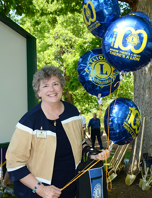 Past Council Chairperson Dr. Dianne Pitts distributed balloons with the Lions 100th Anniversary logo on them.