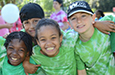 Students smile for the camera during field day.