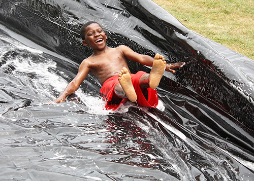 The water slide is a favorite activity at summer camps.