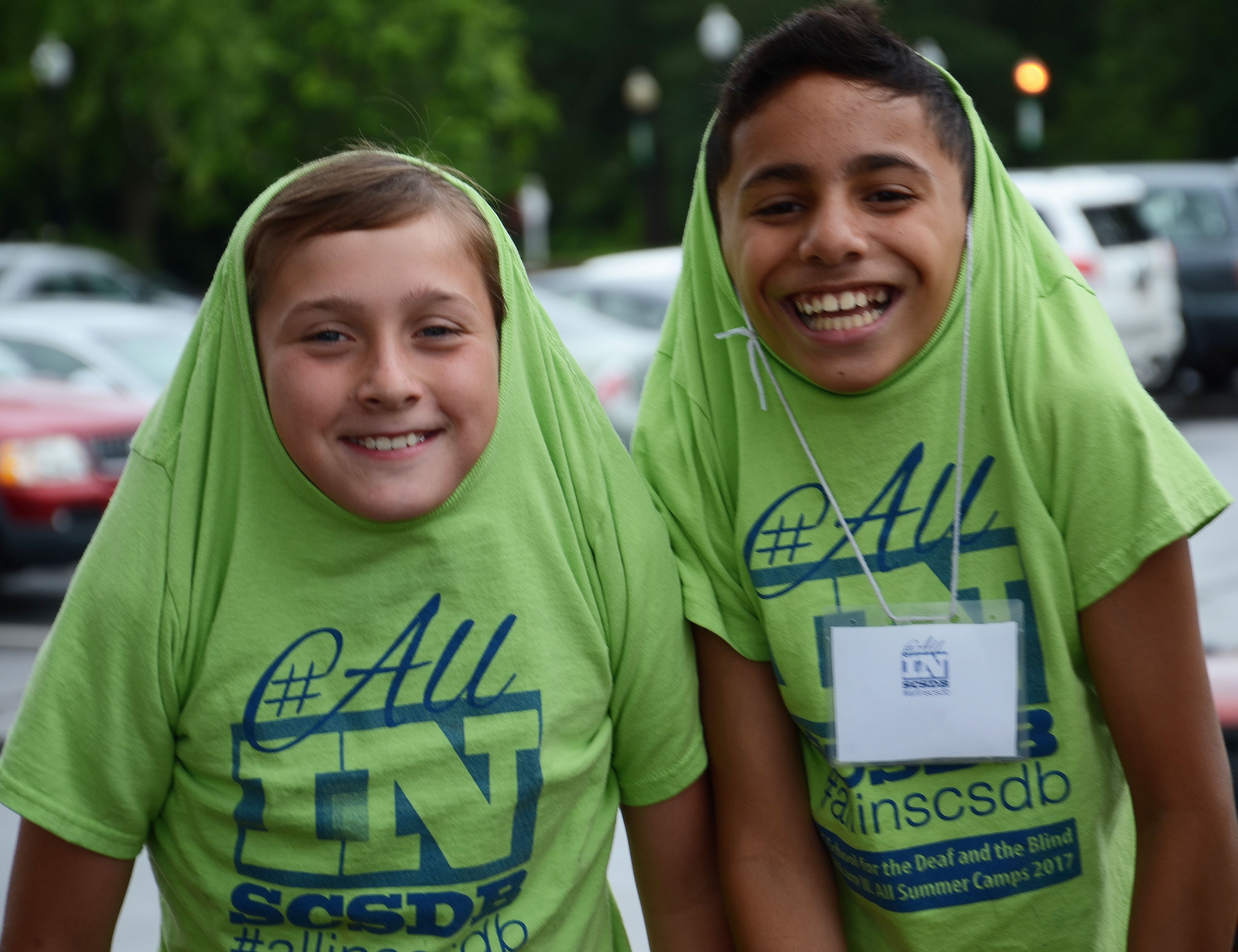 Teen campers pulled their T-shirts over their heads and cut up for the camera.