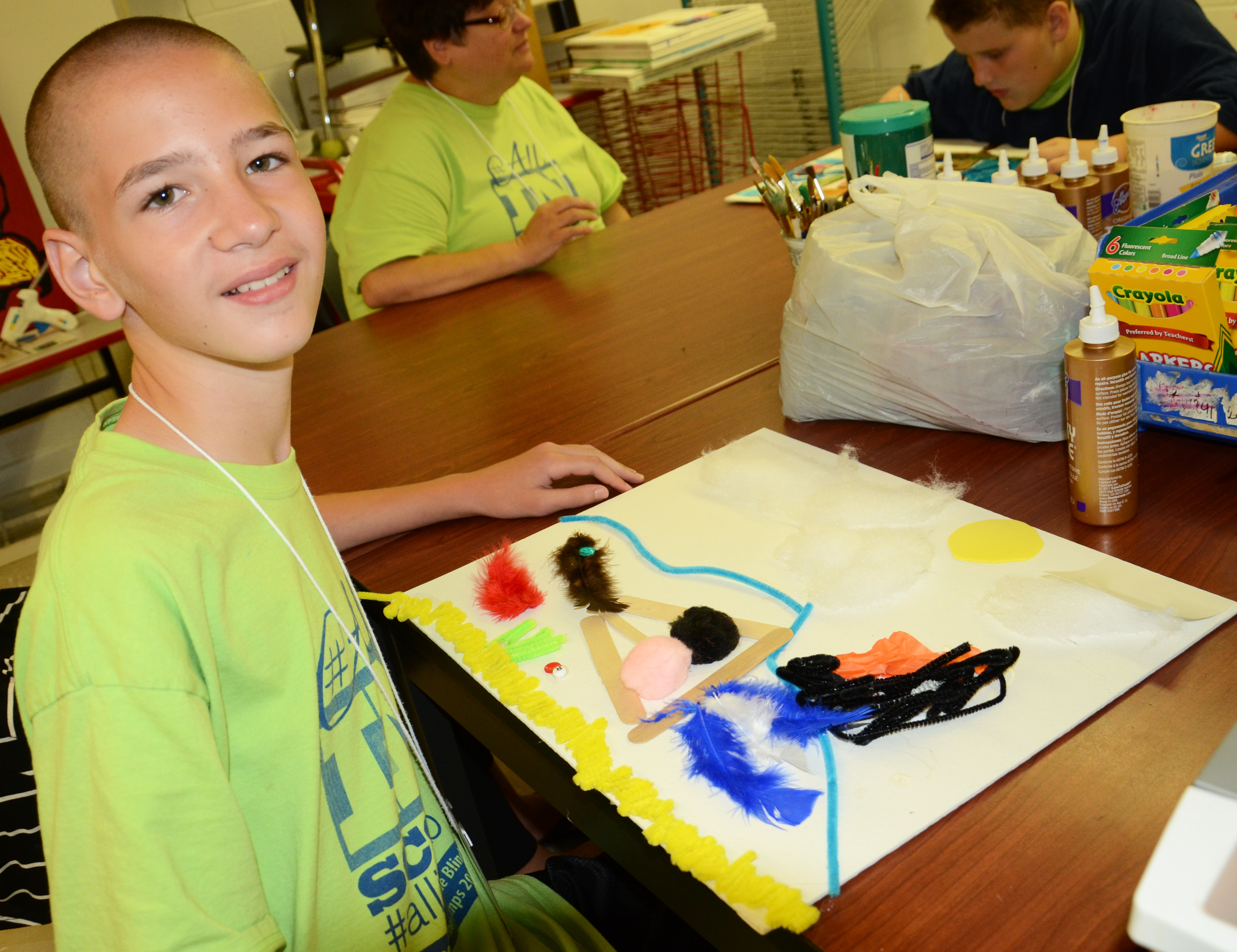 Campers used yarn, popsicle sticks, and a variety of materials to make touchable artwork.