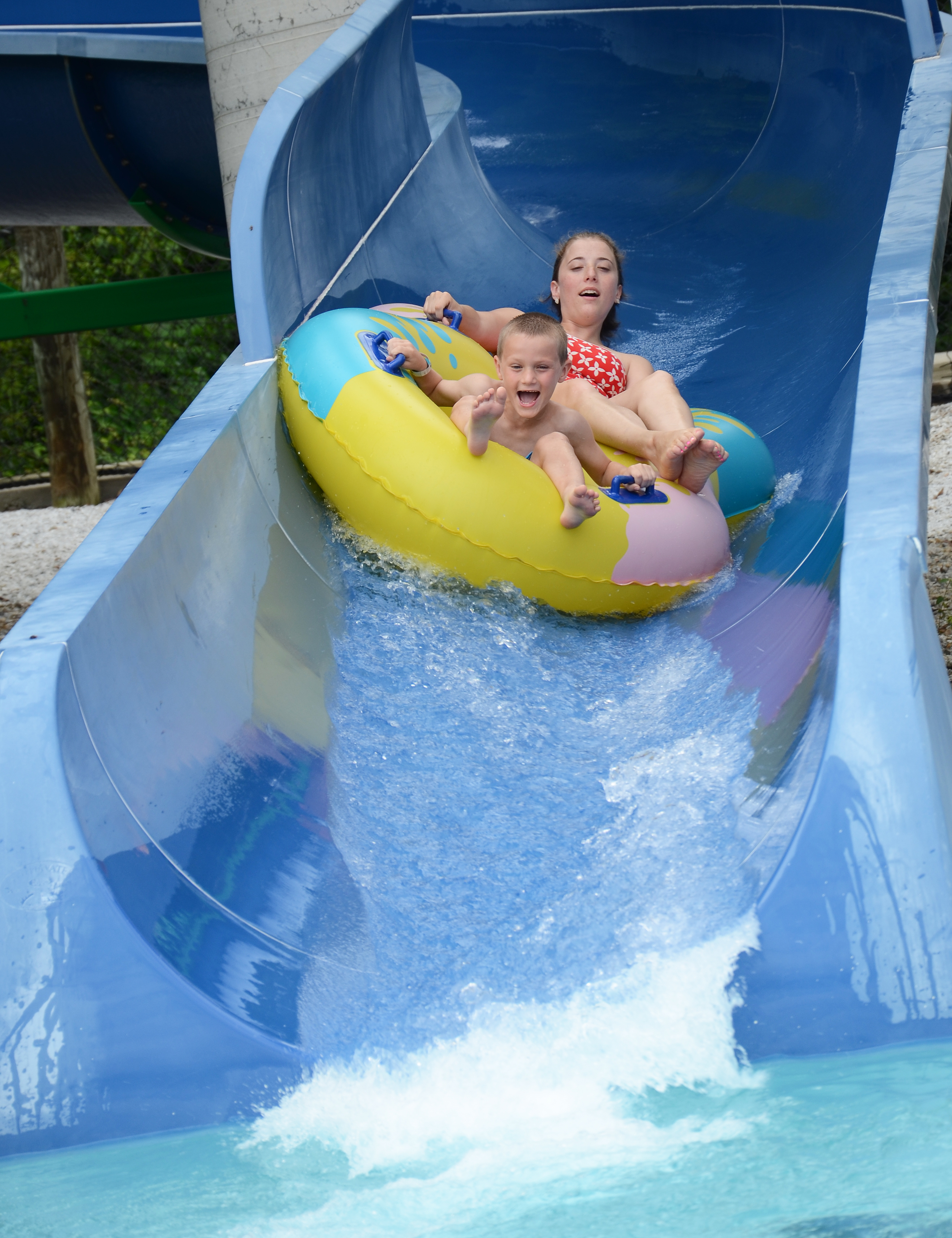 Campers screamed with excitement as they neared the bottom of the slide. out! We're almost to the bottom of the slide!
