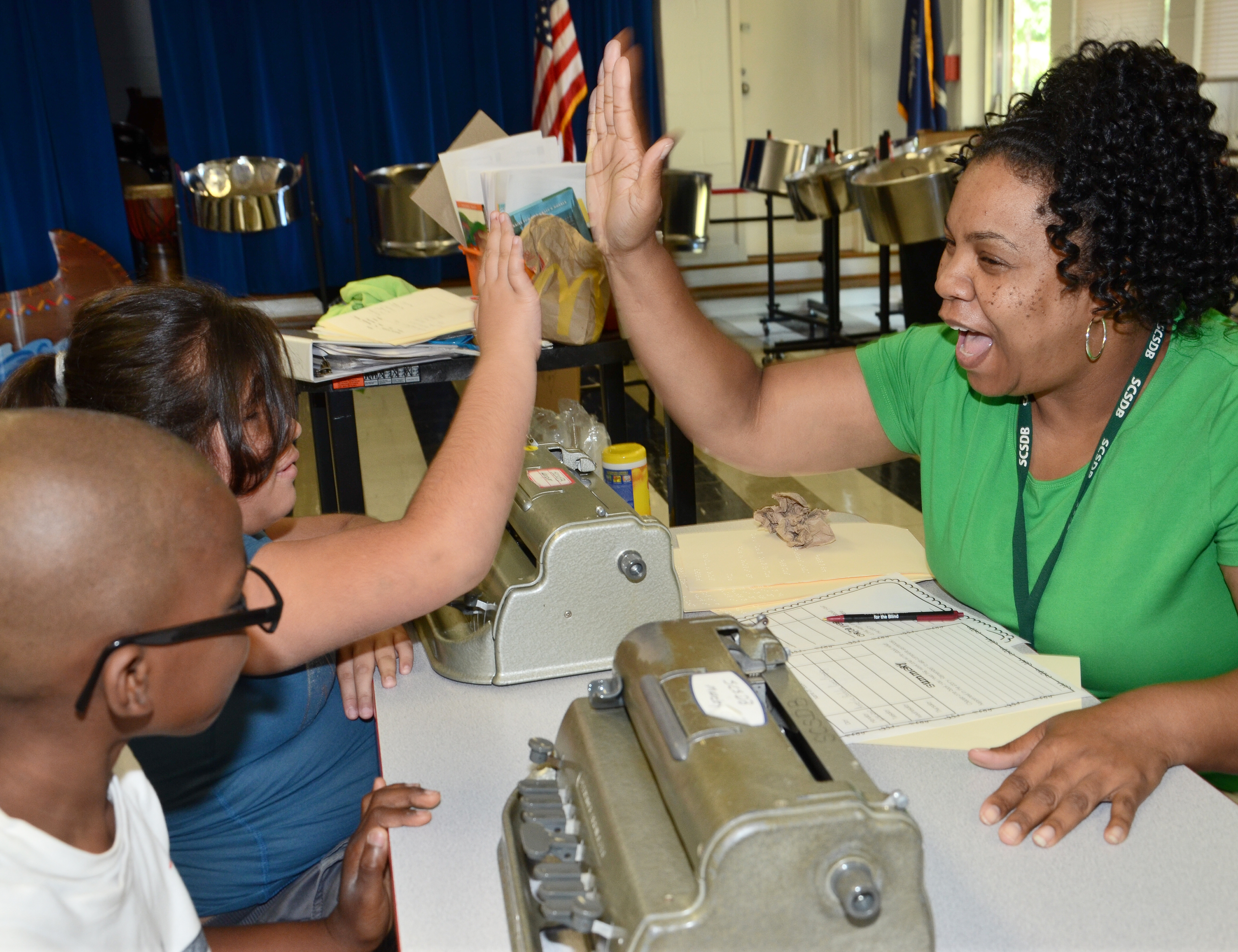 Campers practiced their braille skills and teachers high fived their success.