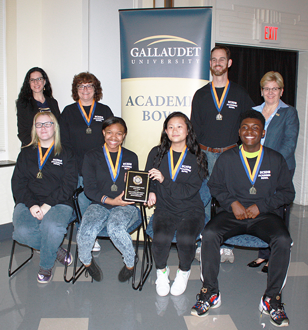 The academic team poses with their medals and plaque for sportsmanship at the Gallaudet University Academic Bowl.