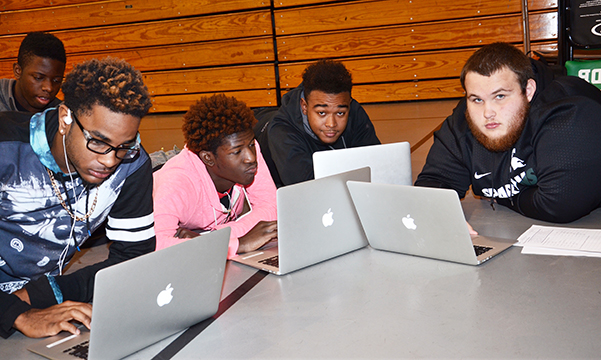 High school students are given MacBooks to use throughout the school year.
