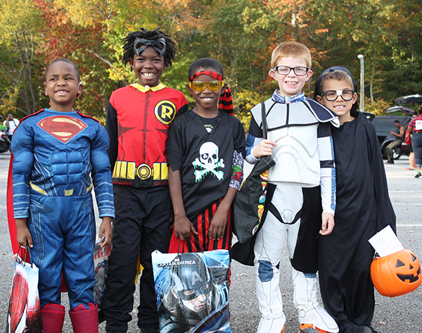 Students show off their Halloween costumes at Trunk or Treat.