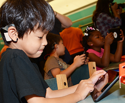 Elementary students are provided tablets to use throughout the school year.