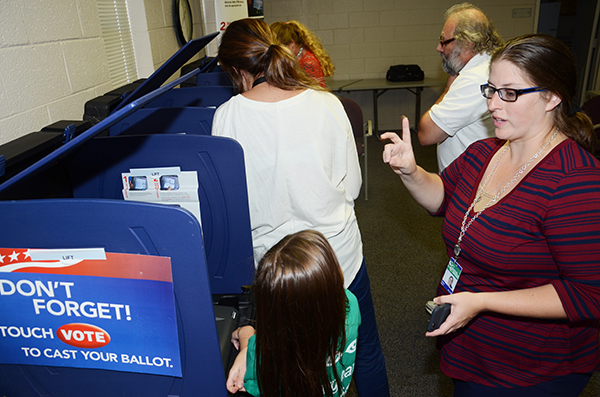 Students learn about voting at simulated polls on the campus.