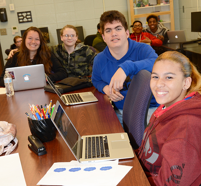 Students take a quick break for a photo in a Foundations of Computing class offered at the Applied Academic Center.