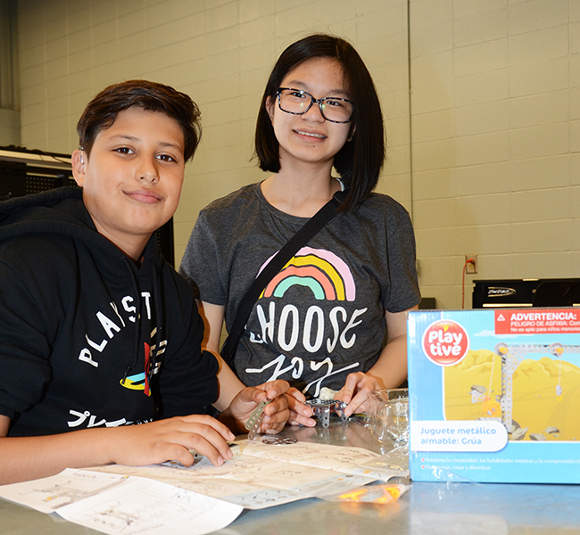 Alan Gaona-Lopez and Victoria Raleigh team up using their skills to complete a STEAM based activity for their careers class. STEAM stands for Science, Technology, Engineering, Arts, Math.