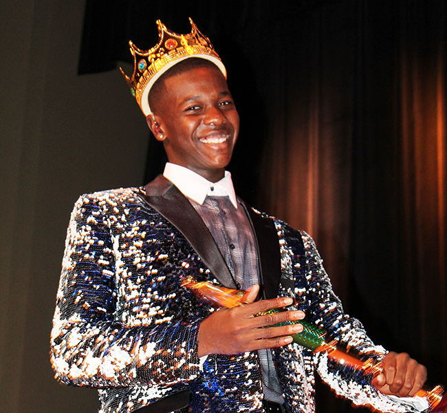 Tyrelle Stevenson celebrates after being named king at the student pageant.