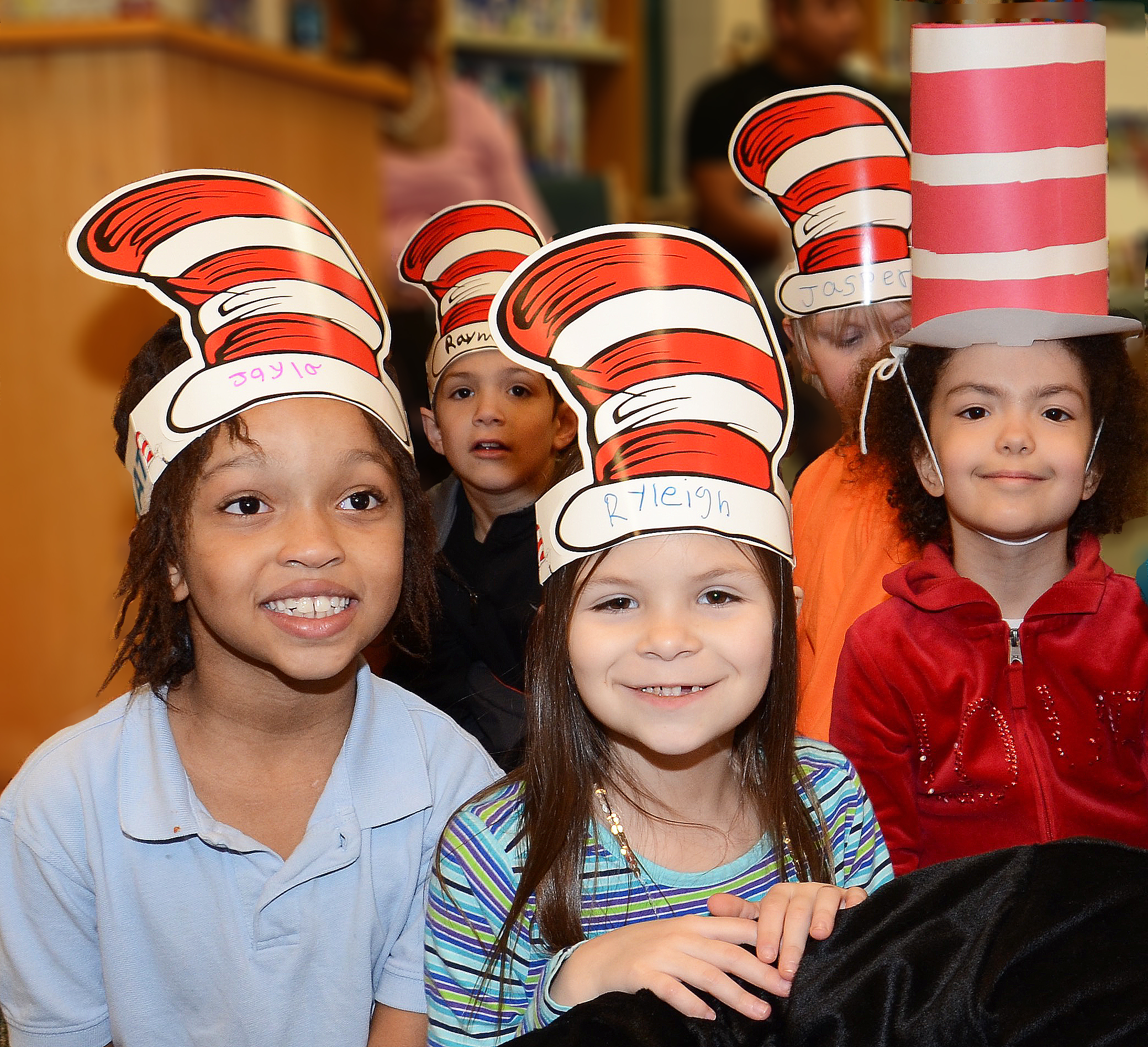 Students show off their Cat in the Hat paper hats.
