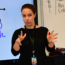 An interpreter communicates with students in a math class.