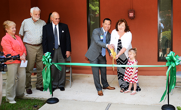 From left to center: Board members Phyllis Alexander, Bob Morrow, and Scott Brawley helped open the Colson Outreach Center.