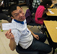 It's Pay Day! Ther Tee Vang is all smiles after receiving his pay check.