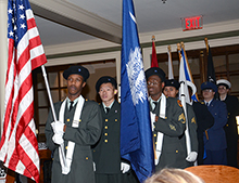 The color guard marched in as the program began.