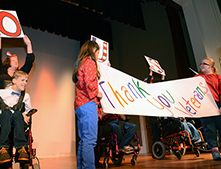 "Students said thank you to veterans with a banner and ""Go USA"" signs."