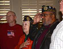Veterans saluted during the pledge of allegiance.