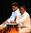 Alexis Strothers-Egleston and Hermani Mesilien beat the drums.