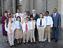 Rep. Mike Forrester and Rep. Harold Mitchell posed for a photo with the students and Dr. Page McCraw.