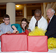 Charter members opened a gift from Lions Clubs International.