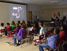 "Middle and high school students watched ""Night at the Museum 3"" with both subtitles and voice description."