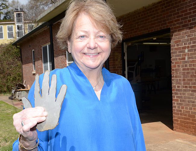 Judy Wilson shows her handshape. Ms. Wilson is a member of The Walker Foundation board.