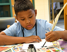 Campers learned to write with a quill during library time.