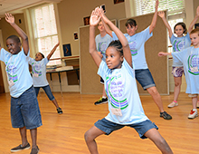 Campers practice their dance steps.