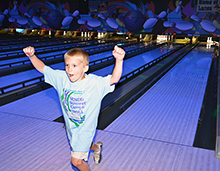 Camper shows his enthusiasm for bowling.