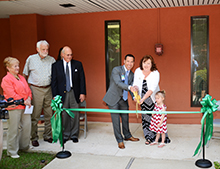 Dawn Norris and Scott Falcone cut the ribbon to open the new outreach center in Charleston along with Dawn's granddaughter.