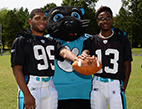 Team captions show off new practice uniforms with Panthers' mascot Sir Purr.