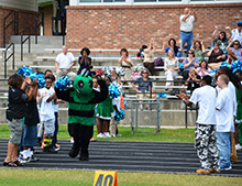 The mascot for the Fighting Hornets runs onto the field.