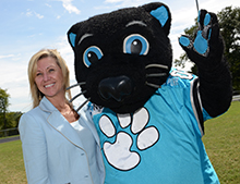 Ann Akerman, chief executive officer of The Walker Foundation, and Sir Purr smile for the camera.