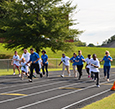 Michelin and Mary Black Foundation executives run with students.