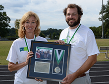 Anna Converse and Matthew Manley of the Mary Black Foundation show their appreciation gift.