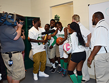 The media taped the athletes as they toured the field house.