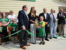 Jasper Womick assisted Bob Novak and Kristen Taylor with the ribbon cutting.