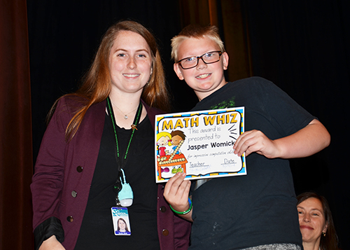Brooke Elliott presents the Math Whiz Award to Jasper Womick.