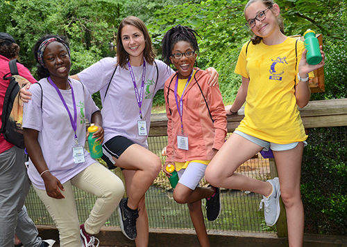 Campers and counselors are all smiles as they cut up for the camera at the Greenville Zoo.