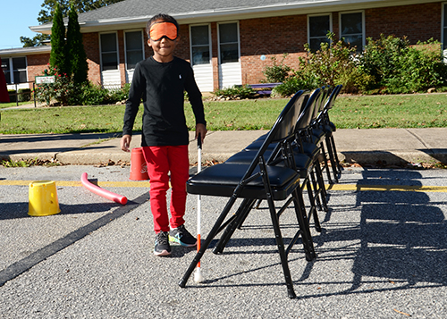 Paulina Speight tests her Orientation and Mobility skills on an obstacle course.