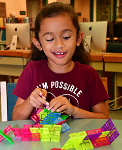 Emily Hernandez builds a model in the library's makerspace.