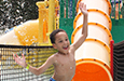 Summer campers enjoyed the water slide at the waterpark.