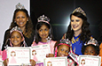 Students show off their princess crowns and certificates.