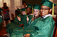 Class of 2014 graduates show off their new diplomas.